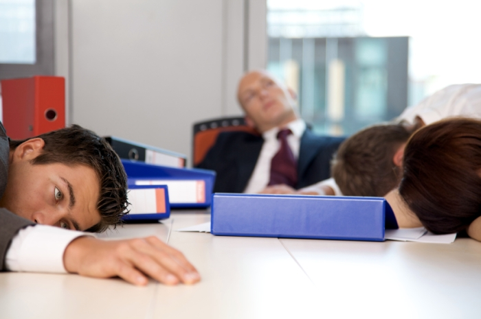 Young business team exchausted and over worked
